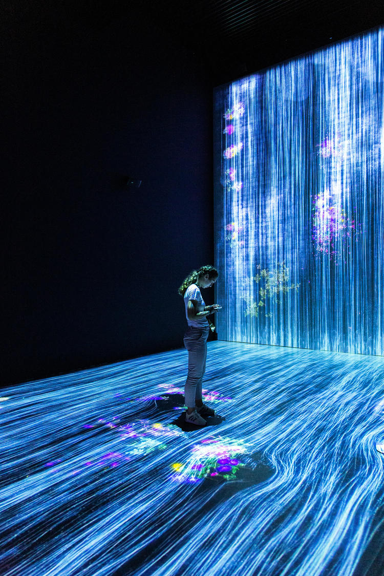 Person standing within flowing data
